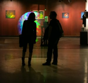 visitors discussing Setsuko Ishii's 'Photon Drawing Series: A Drop of Light', 1998