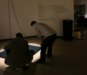 visitors discussing Paula Dawson's 'Hyperobject:Homeland'